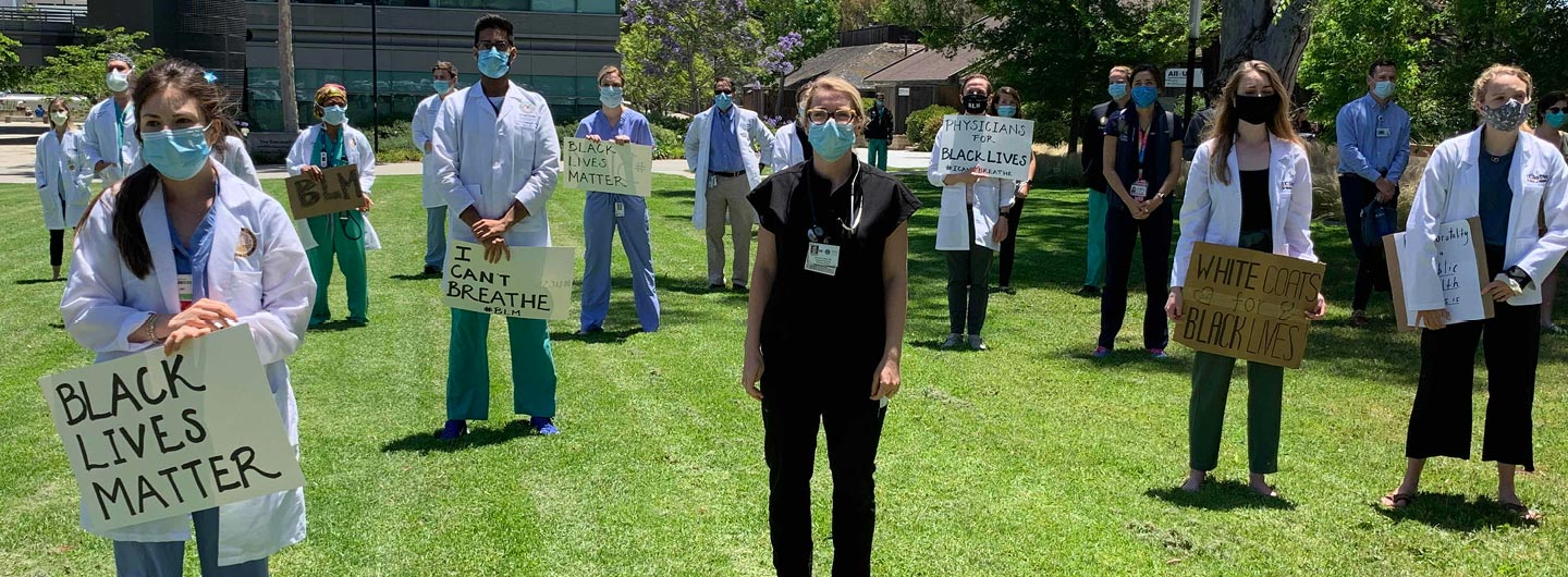 medical workers holding Black Lives Matter signs